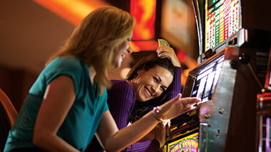 two women at slot machine
