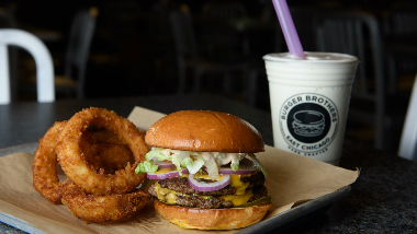 Burger and onion rings with a milkshake